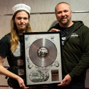 Reunited on the Sabaton Cruise: one man and his merch